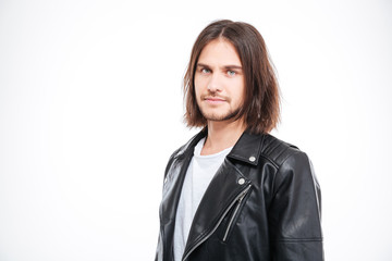 Handsome confident young man in black leather jacket