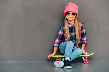 Carefree cutie with skateboard.