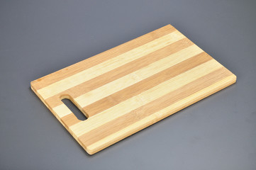 Bamboo chopping board on grey background
