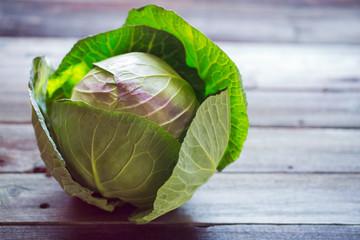 Fresh green garden cabbage on rustic wooden background
