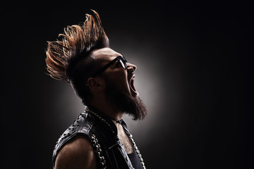 Punk rocker shouting on dark background