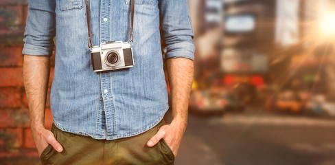 Composite image of hipster man holding digital camera