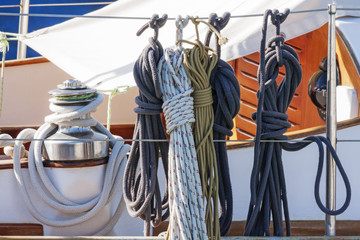 Foto op Aluminium Zeilen Colorful nautical accessories with ropes, pulley and chromed winch on a well equipment wooden sailboat