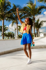 Beautiful teenage black girl in blue skirt take selfie with her