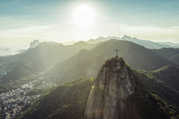 Rio de Janeiro, Brazil : Aerial view of Christ and mountains at sunset