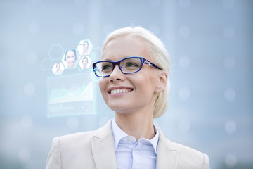 young smiling businesswoman in eyeglasses outdoors