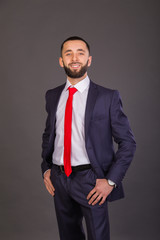 Young stylish businessman in a business suit.