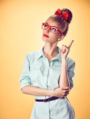 Beauty fashion nerd woman thinking, glasses.Pinup