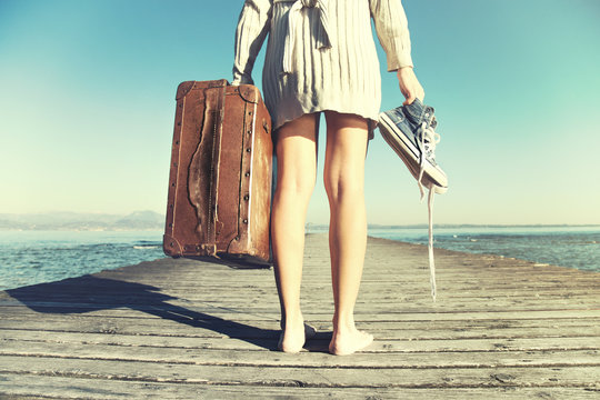 young woman just arrived to destination with her suitcase