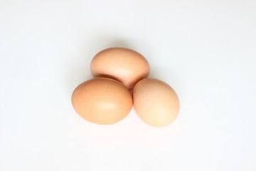 Three eggs on white backgrund