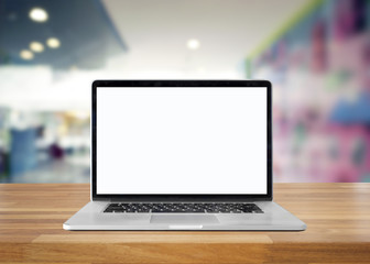 Laptop with blank screen on table. interior background, blurred