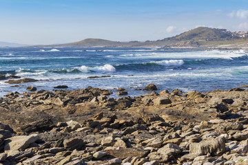 Rocks and wave surf on Insua Cape