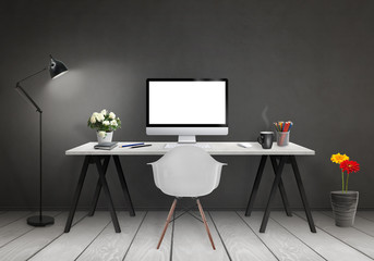 Modern office interior with computer on desk, plants, lamp, chair, books, black wall and white wooden floor.