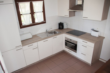 A kitchen in a bright house