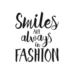Smiles are always in fashion - Hand drawn inspirational lettering quote.