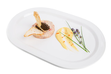 Salmon tartare with black truffle sauce.