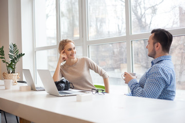 Man and woman coworkers in stylish studio office