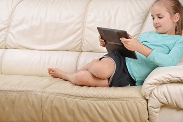 girl  sits on couch