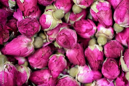 : Rose tea - dried rosebuds flowers texture closeup. Dry roses petals ...