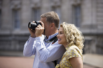 A middle-aged couple taking a photograph