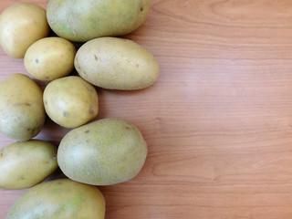 potatoes on wooden base
