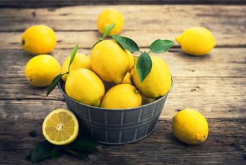 Fresh lemons on the rustic tale