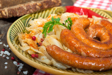 Roasted German style sausages with sour cabbage