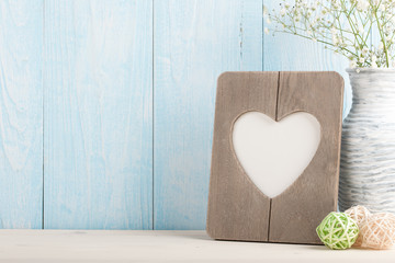 Heart shaped blank frame and white flowers