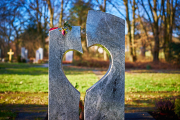 Gravestone with heart withered rose / Tombstone with heart on graveyard