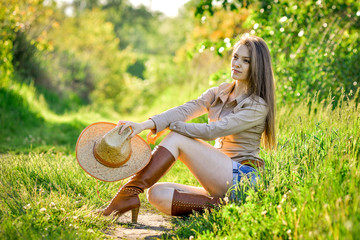 young beautiful girl in a cowboy hat