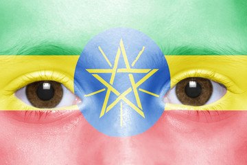 human's face with ethiopian flag