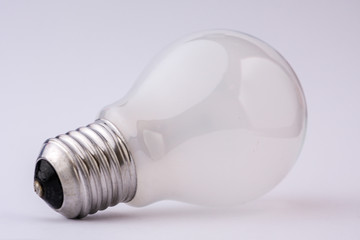 White light bulb on a white background