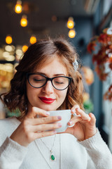 Woman enjoys in a  cup of coffee