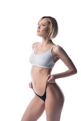 Beddable blonde in underwear pulling her panties