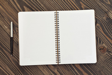 Notepad with blank pages and pen