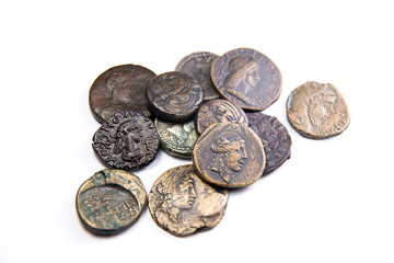 Vintage coins with portraits of kings on over white