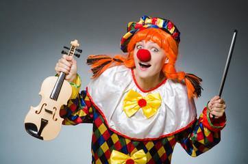 Clown in funny concept on dark background Wall mural