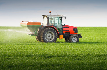 tractor fertilizing in field