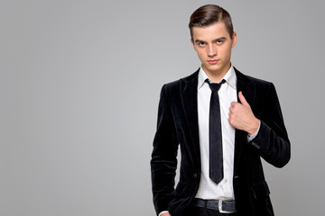 model in a fashionable suit and white shirt Studio