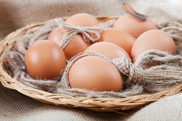 Eggs in a basket on canvas sack