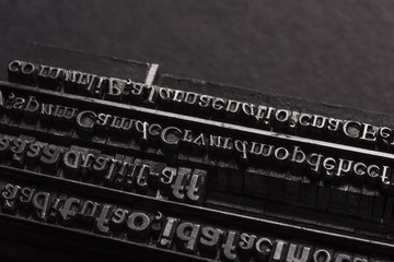 Typographical. Different metal characters, it used to print documents
