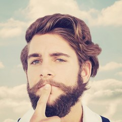 Composite image of portrait of hipster with finger on chin
