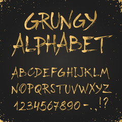 Hand drawn golden alphabet. Uppercase grunge letters and numbers on chalkboard. Handdrawn typography. Modern font.