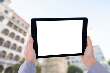 Composite image of cropped hand of man holding digital tablet