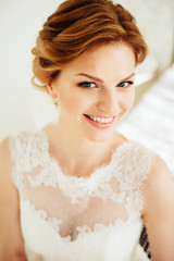 Beautiful and happy bride in white wedding dress.