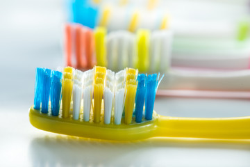 colorful toothbrushes are very close-up