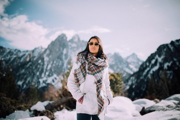 Casual Woman in a Winter Scenery