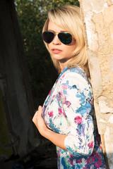 Girl in mirrored blue sunglasses