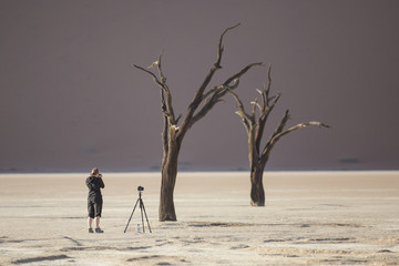 A photographer takes pictures in Deadvlei, Namibia.