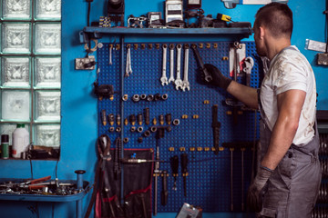 Car mechanic and his tools